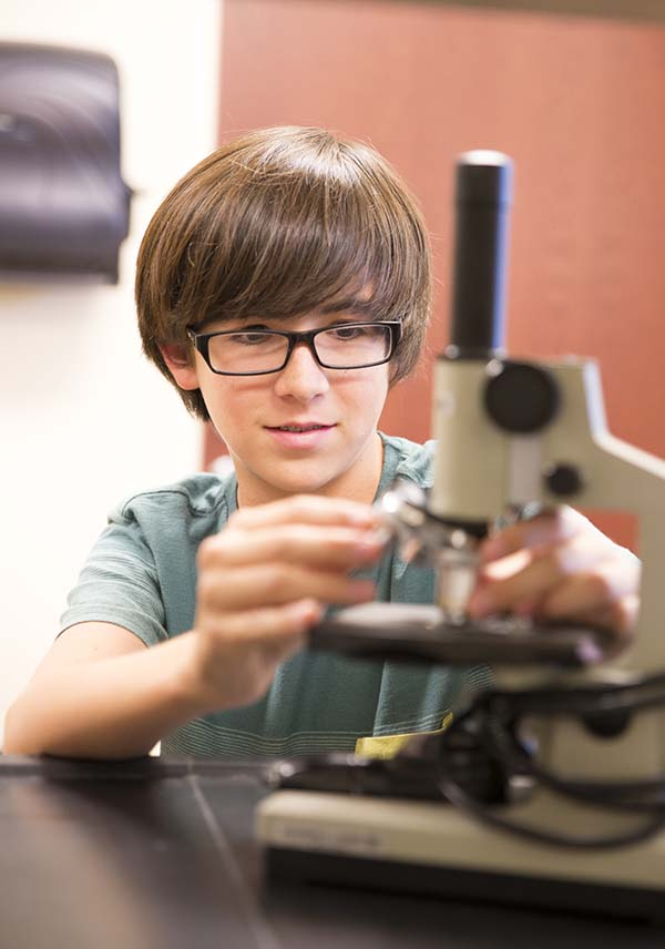 Elgin Academy Science Student Hands on learning with microscope