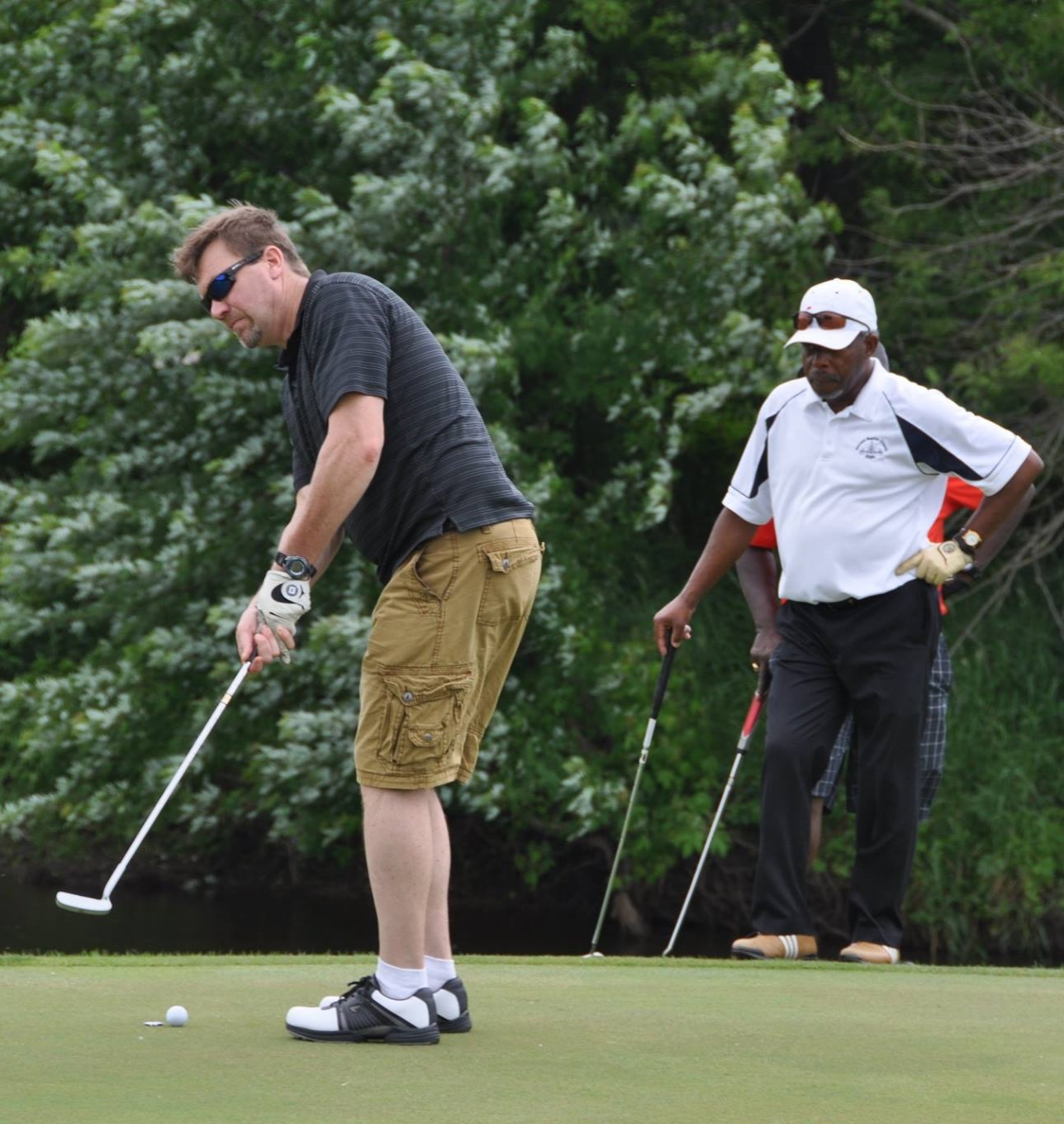 Elgin Academy parents participating at Golf Classic