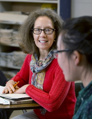 faculty staff helping student for improved academic success
