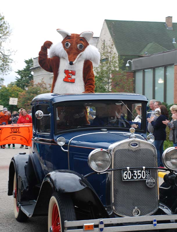 Elgin Academy Fox Mascot Driving in Old Car
