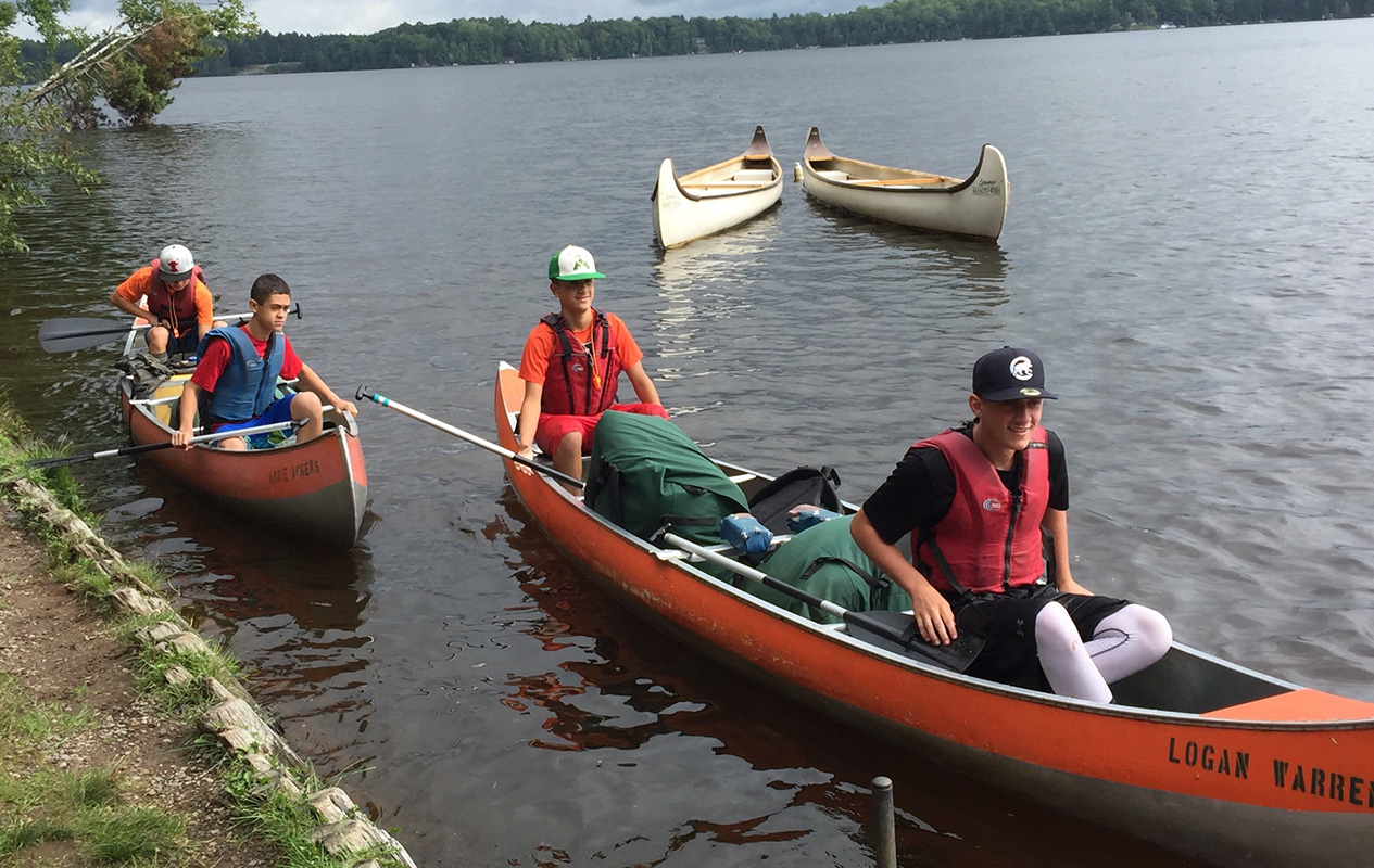 students canoeing on Lake Michigan from private learning academy
