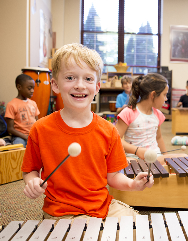 Private elementary student playing the xylophone