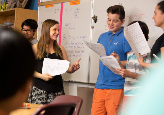 students at Elgin Academy Middle School preparing for theatrical performance