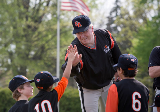 Middle School Athletic coach boosting morale among baseball team