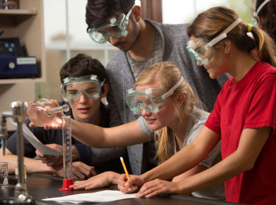 Four private high school students in chemistry lab